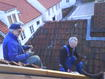 Dad, uncle Rolf and me laying down the roof